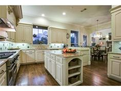 Light kitchen with large windows // Open to the breakfast area, tons of counter space