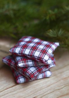 """Cozy hand warmers. 4 pieces of 3""""x3"""" cotton fabric (no blends) and uncooked rice. Pin two pieces of fabric together, wrong side out. Sew around the edges, leaving at least an inch open. Turn square right side out. Fill square 3/4 of the way with rice. Stitch the pocket opening. To use, microwave for 25-30 seconds, cool for a moment, then put in your pocket or gloves to keep warm."""