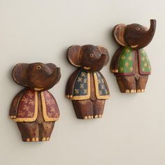 Handcrafted in Indonesia of solid exotic albizia hardwood, our Painted Elephant Hooks make a grand statement in the entryway, bedroom or anywhere else in the house. These helpful hooks add a pop of vibrant artistry no matter where you place them.