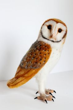 This pretty barn owl is 10.5 inches tall and from the tip of her tail to the top of her head, about 11.5 inches long.    I needle felted the barn