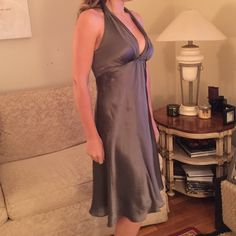 """Silver Party Halter Dress This cute dress is super comfortable and was only used once to a party. Just a little stretch, but true to size. Total length from bust down is 27"""". 100% silk with polyester inner lining White House Black Market Dresses Midi"""
