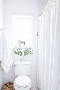 white bathroom with hints of palm trees //