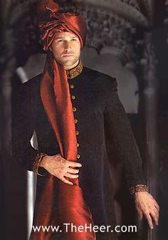 Rust color of turban for mehndi sherwani with cream colored kurta and pajama underneath