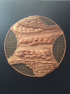 Large 40 inch diameter fiber art piece. Don Freedman. Made of wool, jute,silk cotton,wood and steel. Really a wow piece. great condition