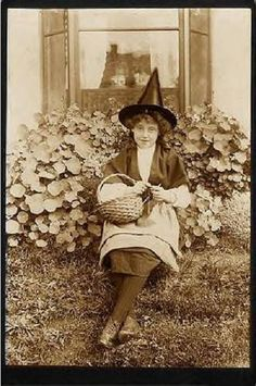 a girl in a witch costume.I love the nasturtiums in the background. Halloween Club, Fall Halloween, Halloween Witches, Halloween Ideas, Vintage Photographs, Vintage Photos, Vintage Halloween Photos, Beautiful Dark Art, Creepy Photos