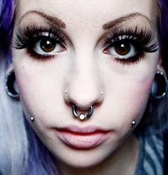 Septum...double nose...cheek...stretch ear...cool piercing.