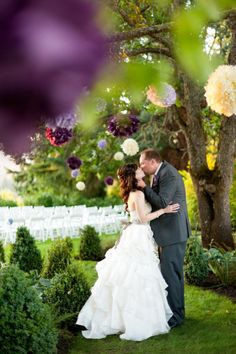 Wedding of the Week: Pretty in Purple! Love the idea of hanging things in trees it so romantic...Maybe can hang them on palm trees outside for photos? or by cocktail hour area by picnic tables? can get purple lanterns from craft store.