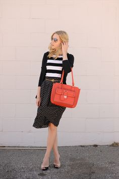 black cardi + b and white stripey top + b and white polkadot skirt + pop of color, probably belt and/or shoes