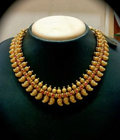 22 carat gold antique finish South india traditional mango necklace studded with rubies.
