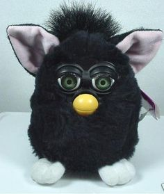 "2001 Furby Electronic - All Black by Tiger Electronic LTD. $45.00. Furbys can communicate with one another via an infrared port located between their eyes. Furbys start out speaking entirely Furbish, a language with short words, simple syllables, and various other sounds, but are programmed to speak less and less Furbish and more and more English as they ""grow""."