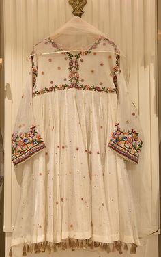 Blend of pure cotton net peplum with anchor embroidery and zardosi handwork, paired with raw silk trousers and net dupatta.   Delivery Time: 4 to 8 weeks Stylish Dresses For Girls, Frocks For Girls, Girls Formal Dresses, Party Wear Dresses, Simple Dresses, Pretty Dresses, Casual Dresses, Casual Wear, Pakistani Fashion Party Wear