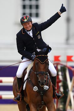 Michael Jung of Germany riding Sam celebrates winning the Gold medal in the Individual Jumping Equestrian Final on Day 4 of the London 2012 Olympic Games at Greenwich Park on July 31, 2012 in London, England.