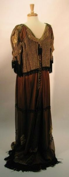 Lovely and grand back view of the 1912 George and Mary court and ball gown. Closure is 18 black glass buttons decorated with gold leaf.