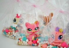 Littlest pet shop party favors  ( best idea EVER! )I would go to that party any day of any week of any month of any year! It's just so awesome and the cat is beyond adorable!!!!!!!!