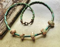 Handmade porcelain beads by Sheri Mallery, Turquoise tubes and seed beads adorn this necklace..