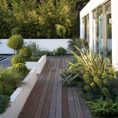 Garden decking with raised beds painted in white