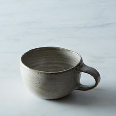 Wheel-thrown stoneware mug. Just the right shape and size for warming hands while sipping.