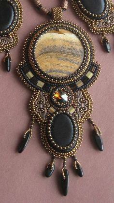 Like the use of brass filigree, nice addition to the beads