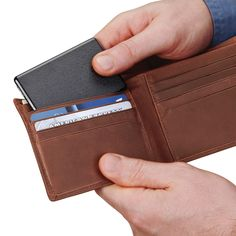 The Credit Card Sized Cell Phone Backup Battery - Hammacher Schlemmer - This cordless cell phone backup battery stores in a wallet and provides an additional hour of power.