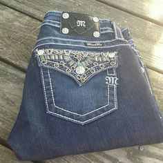 "Miss Me Boot Cut  Bling Jeans! Miss  Me Boot Cut Bling Jeans. Size 27, inseam 30"". Intricate Bling on back pockets. Miss Me Jeans Boot Cut"