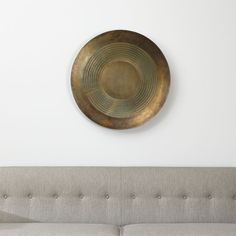 Shop Disc Metal Wall Art. Reading both ancient and modern, this decorative disc metal wall art has the intriguing appeal of a found object. Made of cast aluminum, the disc is partially etched with concentric circles of intricately texture.