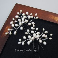I love how elegant these pearl branches are. They could look fabulous in the low chignon.