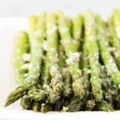 Oven Roasted Asparagus with Garlic, Parmesan, & Lemon is a quick and easy side dish that is especially delicious in Springtime when asparagus is in season! recipes baked oven roasted olive oils Oven Roasted Asparagus with Garlic, Parmesan, & Lemon Oven Roasted Asparagus, How To Cook Asparagus, Asparagus Recipe, Roasted Veggies In Oven, Roasted Vegetable Recipes, Veggie Recipes, Veggie Dishes, Fermentation Recipes, Lean And Green Meals