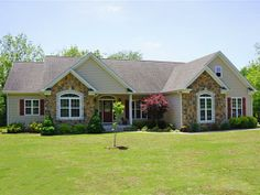 Custom Built home on acre lot, Joplin, MO. Comfortable open floor plan with granite counters and stainless appliances.