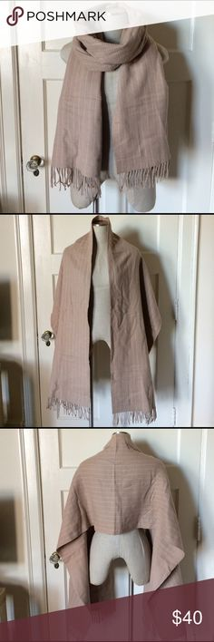 Club Monaco tan scarf/wrap/shawl Super cozy and in great condition. There are a few small pills in the center back. Otherwise this scarf/wrap is pretty great. Color is a beautiful camel color. Will match everything! Perfect for winter or a transitional piece as the seasons change. Club Monaco Accessories Scarves & Wraps