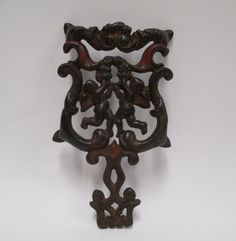 Vintage Wilton Cherub Trivet Cast Iron 7 Footed by retrogal415
