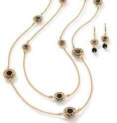 "Avon: Long Layered Station Necklace and Earring Gift Set  Modern Glamour.  Long double row goldtone necklace with multiple stations with black faceted beads. Includes matching earrings. Double-strand necklace, 24 1/2"" L with 3 1/2"" extender. 1 1/2"" L pierced earrings.  Fashion Jewelry Sale - 2 for $18!   Deal effective March 12th 2014 midnight."
