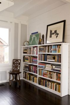 Bookcase in Kate and Andy Spade's Southampton home decorated by Steven Sclaroff...