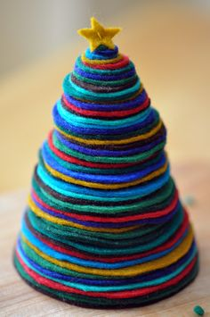 Love this mini felt Christmas tree craft from Quince and Quire.