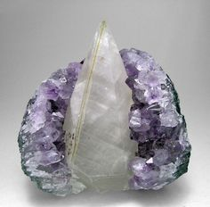 Calcite with Amethyst and Hematite. cleansing, balancing, loving, calming, enhanced psychic abilities