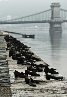 The Shoes on the Danube Bank in Budapest, Hungary This memorial was conceived of by film director Can Togay with sculptor Gyula Pauer to commemorate the Jewish people killed by fascist Arrow Cross militiamen in WWII. The men were ordered to take off their shoes and they were then shot so their bodies would fall into the water (leaving their shoes on the bank). Therefore, the sculpture honors the men in the face of this terrible act.
