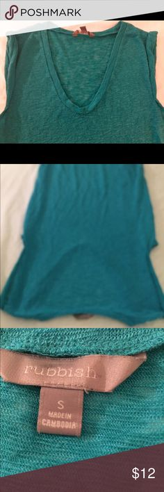 RUBBISH TEAL: turquoise Top/blouse This is a nice teal turquoise comfortable flowy top also has two slits on the side you could wear with anything the color of the tub is best shown in the photo with the tag you will love how the top feels Rubbish Tops Blouses
