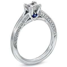 Loooove. Princess cut diamond in a white gold band with little diamonds surrounding the big diamonds... Oh lord