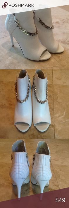 Leather Peep Toe Booties by Guess NWOT Beautiful leather with silver accents. Heel is 4 inches high. Side zippers. New...never worn. Guess Shoes Ankle Boots & Booties