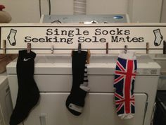"""""""Single Socks Seeking Sole Mates"""" hand made distressed wooden sign complete with different sized clothes pins to help avoid the dryer black hole effect of losing the matching pair of socks! Made to be hung on a wall (incl. hardware). Perfect for a laundry room or gift. Can personalize as well. $30"""