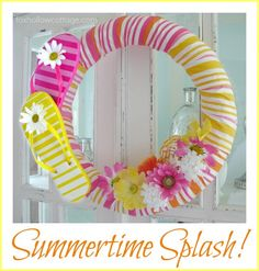 flip-flop-wreath - i mostly just like how to build the wreath part out of pool noodles and fabric!