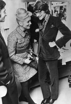 French actress Catherine Deneuve with French fashion designer Yves Saint-Laurent backstage at one of Saint- Laurent's fashion shows, Paris, 30th January 1968.(Catherine wearing a model by Yves Saint Laurent).