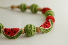Too cute but pattern NOT in English -- suggested to crochet around beads for melons, then make slices from a circle (red in the middle, then white then green and fold in half over necklace -- embroider seeds with black!  Cuteness abounds!