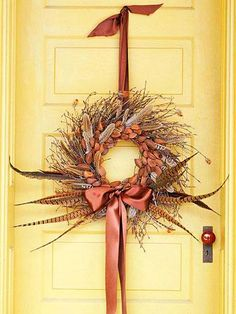 Fall Wreath - Photo inspiration - Add Pheasant Feathers and dried seed pods or nuts to a twig wreath; embellish with brown satin bow and hanging loop - Elegant! Feather Wreath, Twig Wreath, Wreath Crafts, Door Wreaths, Wreath Ideas, Feather Crafts, Burlap Wreath, Autumn Wreaths, Holiday Wreaths