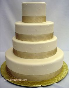 "love the simple ""pearls"" around the cake! perfect tiers too!!"
