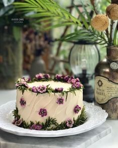 Beautiful and simple spring cake. I love the greenery and purple flowers made from buttercream! Pretty Birthday Cakes, Pretty Cakes, Cute Cakes, Beautiful Cakes, Amazing Cakes, Cake Decorating Frosting, Cake Decorating Designs, Cake Decorating Techniques, Cake Designs