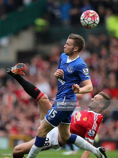 Morgan Schneiderlin of Manchester United competes with Tom Cleverley of Everton during the Barclays Premier League match between Manchester United and Everton at Old Trafford on April 3, 2016 in Manchester, England.