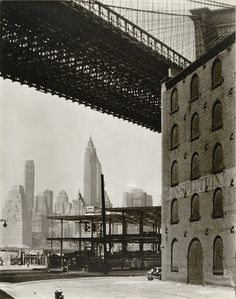 Berenice Abbott: I like how the buildings in the background are a little faded giving the photo depth.
