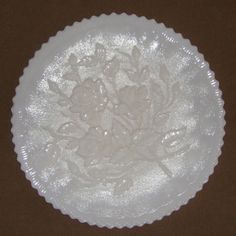 "Here is a very rare find, a collector delight, it is an ""Imperial Canapé Vintage Milk Glass Rose"" cake plate. It has scalloped edge and a raised pattern on the front and back of the plate. You may won"