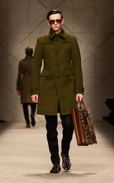 Olive wool twill donkey coat and spotted animal print tote bag on the runway of the Burberry A/W13 Menswear show