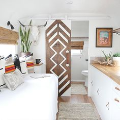 This remodeled RV has the coziest fireplace you ve ever seen in a tiny home Mountain Modern Life Airstream Renovation, Airstream Remodel, Travel Trailer Remodel, Travel Trailers, Camper Makeover, Cozy Fireplace, Remodeled Campers, Mobile Home, Glamping